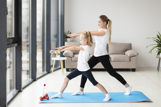side-view-mother-exercising-along-with-child-home_23-2148492534.jpg
